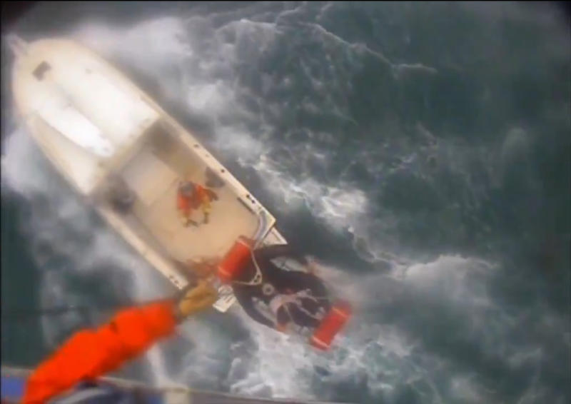 """In this Saturday afternoon, Dec. 21, 2019, video image released by the U.S. Coast Guard shows a man, wearing a full-body wetsuit, being hoisted up from the boat into the helicopter near Santa Rosa Island, one of the Channel Islands in Southern California. A shark reportedly bit a surfer Saturday afternoon in a """"truly terrifying situation,"""" the Coast Guard said. The 37-year-old man had been surfing near Santa Rosa Island, one of the Channel Islands, during the attack, according to a news release. (U.S. Coast Guard Los Angeles via AP)"""