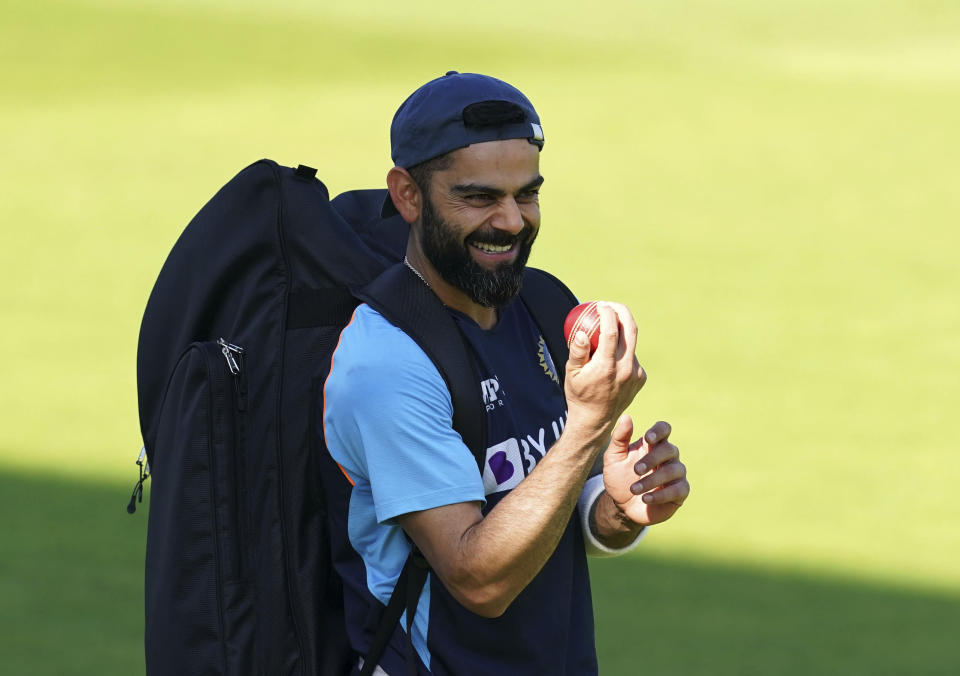 India's Virat Kohli smiles during the nets session at Old Trafford, Manchester, England, Wednesday Sept. 8, 2021 ahead of the fifth cricket test against England. (Martin Rickett/PA via AP)