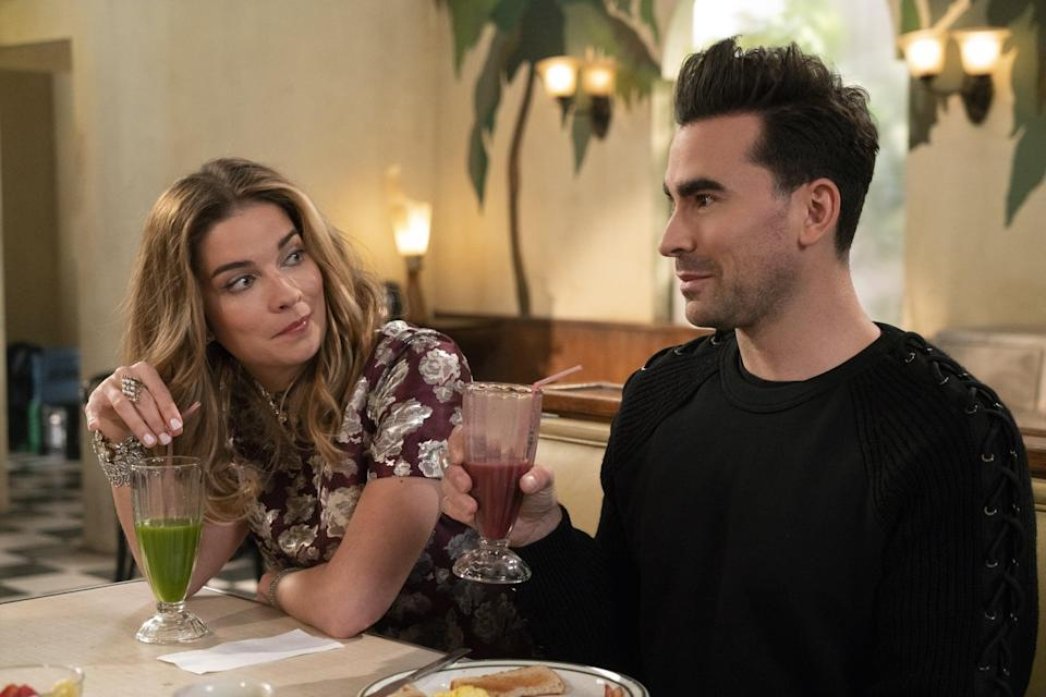 """<p><a href=""""http://www.popsugar.com/Schitt%E2%80%99s-Creek"""" class=""""link rapid-noclick-resp"""" rel=""""nofollow noopener"""" target=""""_blank"""" data-ylk=""""slk:Schitt's Creek""""><strong>Schitt's Creek</strong></a>, much like the new Murphy project, is a comedy about the ultraprivileged, except with a less acidic tone. It follows the rich Rose family as they find themselves broke and living in a motel that they previously bought as a joke. </p> <p><a href=""""https://www.netflix.com/title/80036165"""" class=""""link rapid-noclick-resp"""" rel=""""nofollow noopener"""" target=""""_blank"""" data-ylk=""""slk:Watch it here."""">Watch it here. </a></p>"""
