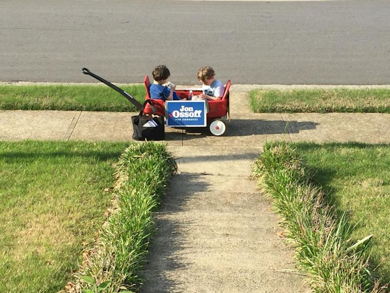Two very young canvassers going – being pulled – door to door in support of Jon Ossoff (David Usborne)