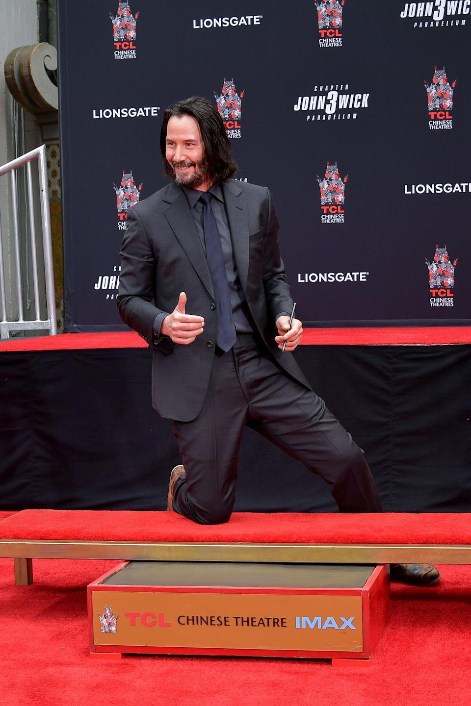 Reeves places his hands in cement at TCL Chinese Theatre IMAX in Hollywood, California.