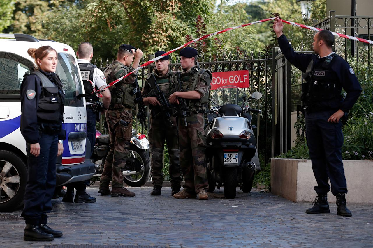 <p>Police and soldiers secure the scene where French soliders were hit and injured by a vehicle in the western Paris suburb of Levallois-Perret, France, August 9, 2017. (Photo: Benoit Tessier/Reuters) </p>