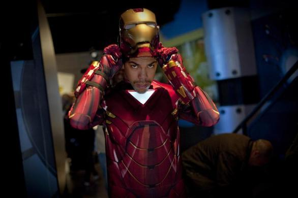 "Comic book fan Sergio Felipe puts on his Iron Man character mask at the unveiling of the ""Marvel Superhero Experience"" at Madame Tussauds wax museum in New York April 26, 2012. The museum unveiled wax statues based on the the Marvel Entertainment film ""The Avengers."""