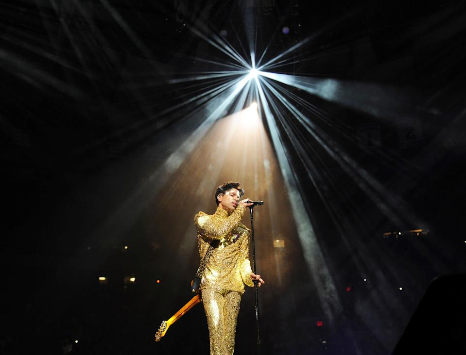 """Prince performing on stage. The late trailblazer was best known for '80s chart-toppers including """"Let's Go Crazy,"""" """"Kiss"""" and """"When Doves Cry."""""""