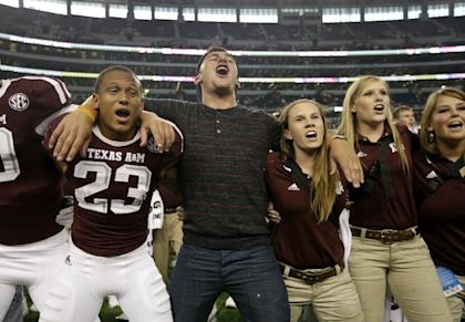 Johnny Manziel joins Armani Watts (23) and the rest of the team and staff to celebrate after beating Arkansas. (AP)