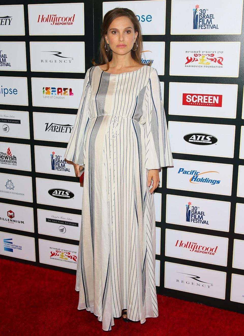<p>Wearing a quietly elegant long-sleeved dress from The Row, Natalie defied overtly glamorous red carpet conventions at the Israel Film Festival's 30th anniversary dinner. [Photo: Getty] </p>