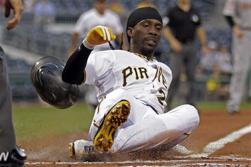 Pittsburgh Pirates' Andrew McCutchen scores on a single by Pirates' Gaby Sanchez off Houston Astros pitcher Fernando Abad during the first inning of a baseball game in Pittsburgh, Wednesday, Sept. 5, 2012. (AP Photo/Gene J. Puskar)