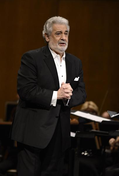 FILE - In this June 7, 2013 file photo, tenor Placido Domingo performs at the Dorothy Chandler Pavilion in Los Angeles. Domingo is in the hospital after suffering a blockage in an artery of the lungs. Domingo's publicist says the 72-year-old is expected to make a full recovery but will have to miss at least two appearances scheduled for later this month. He was admitted to the hospital Monday, July 8, 2013, in Madrid. (Photo by Dan Steinberg/Invision/AP, File)
