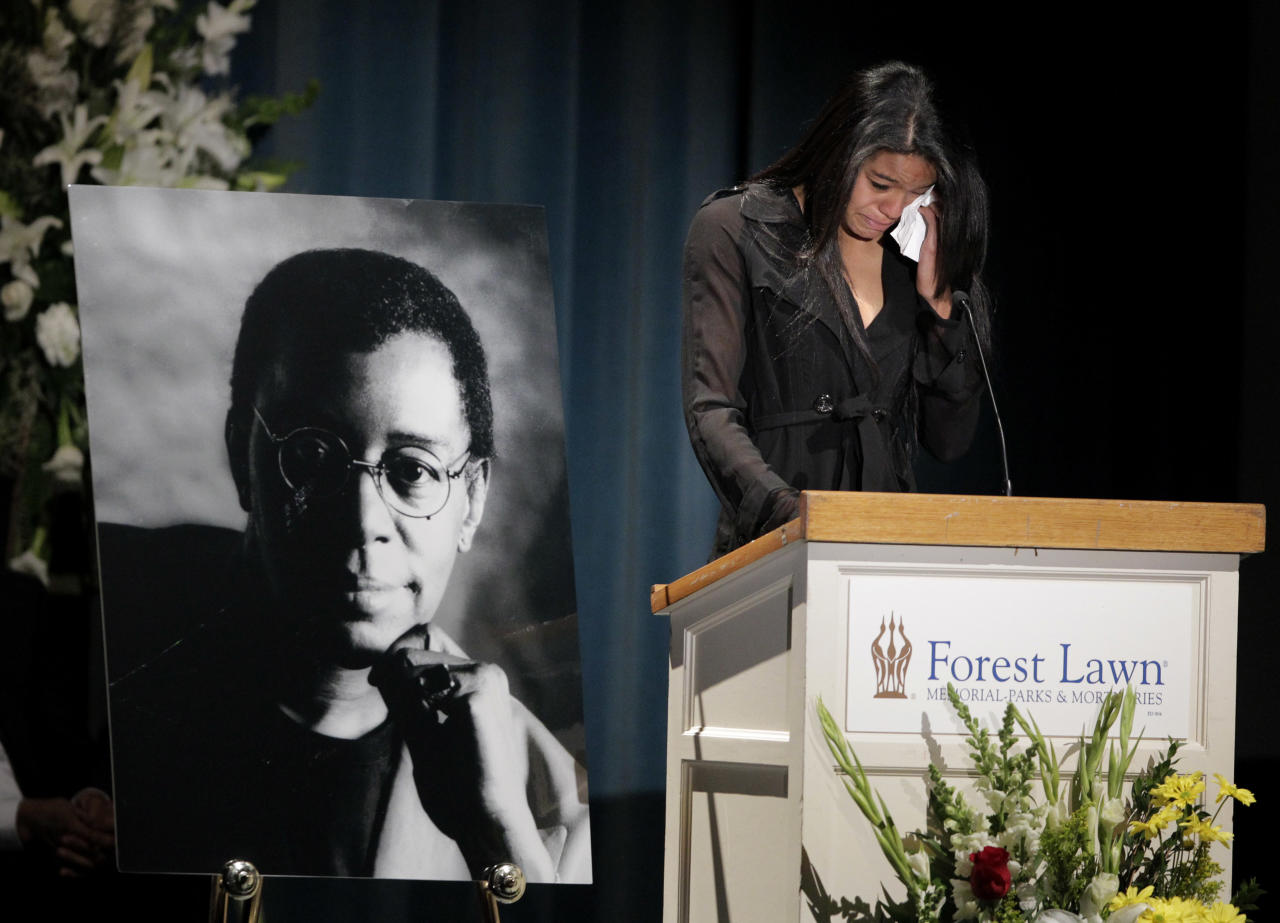 """Christina Cornelius, granddaughter of Don Cornelius, wipes her tears while reading a statement during a private memorial service for """"Soul Train"""" creator and host Don Cornelius in Los Angeles, Thursday, Feb. 16, 2012. Cornelius died Feb. 1 from a self-inflicted gunshot wound. Since then, tributes to him and the show he created have been held around the country. (AP Photo/Jae C. Hong)"""
