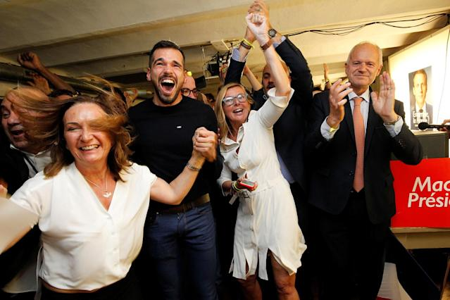 <p>Supporters of French presidential candidate Emmanuel Macron, head of the political movement En Marche !, react after announcement in the second round of 2017 French presidential election at En Marche ! local headquarters in Marseille, France, May 7, 2017. (Philippe Laurenson/Reuters) </p>