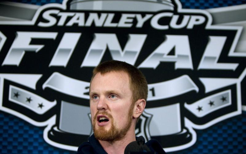 Vancouver Canucks' Henrik Sedin, of Sweden, takes part in a media availability following a team hockey practice at Rogers Arena, Tuesday, May 31, 2011, in Vancouver, British Columbia. The Canucks will face the Boston Bruins in the NHL Stanley Cup Final. (AP Photo/The Canadian Press, Jonathan Hayward)
