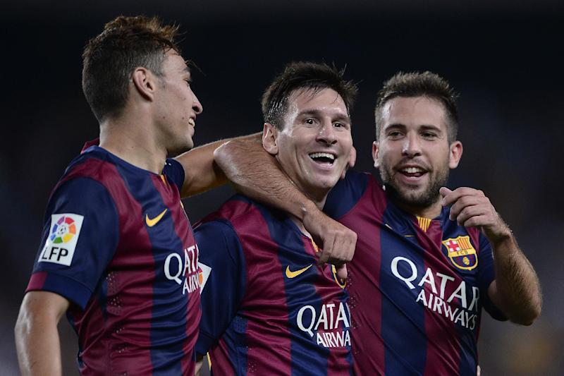Barcelona's Argentinian forward Lionel Messi (C) is congratulated by teammate Jordi Alba (R) and Munir after scoring during a match in Barcelona on August 24, 2014