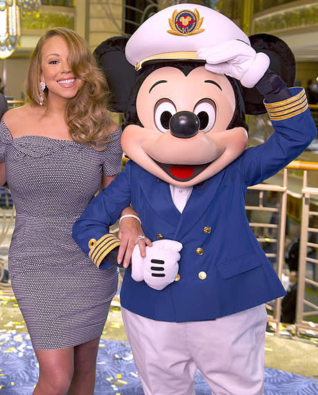 Mariah Carey with Mickey Mouse in 2012