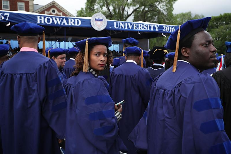 WASHINGTON, DC - MAY 07: Brittani Saafir-Callaway of Cleveland, Ohio, waits with other members of the class of 2016 for the beginning of the 2016 commencement ceremony at Howard University May 7, 2016 in Washington, DC. President Obama is the sixth sitting U.S. president to deliver the commencement speech at Howard University. (Photo by Alex Wong/Getty Images)