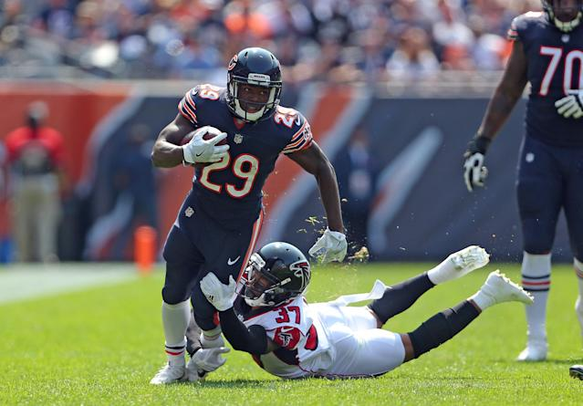<p>Chicago Bears running back Tarik Cohen (29) runs past Atlanta Falcons free safety Ricardo Allen (37) during the first quarter at Soldier Field. Mandatory Credit: Dennis Wierzbicki-USA TODAY Sports </p>