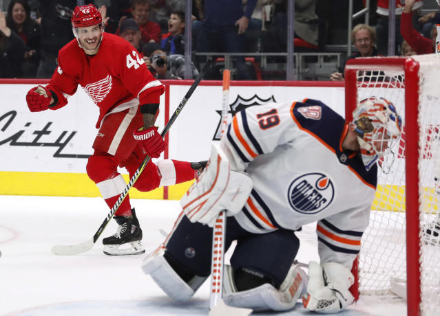 Detroit Red Wings right wing Martin Frk (42) looks back as Edmonton Oilers goaltender Mikko Koskinen (19) reaches for the puck during the second period of an NHL hockey game, Saturday, Nov. 3, 2018, in Detroit. Frk was credited with an assist on the goal by defenseman Danny DeKeyser. (AP Photo/Carlos Osorio)