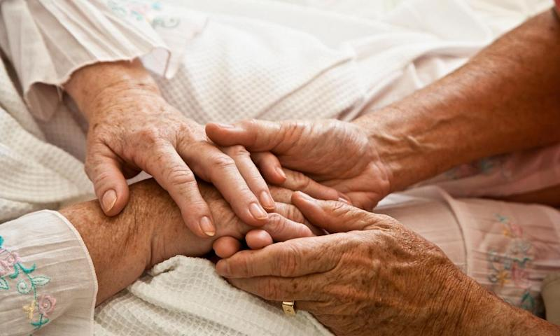 Old people holding hands