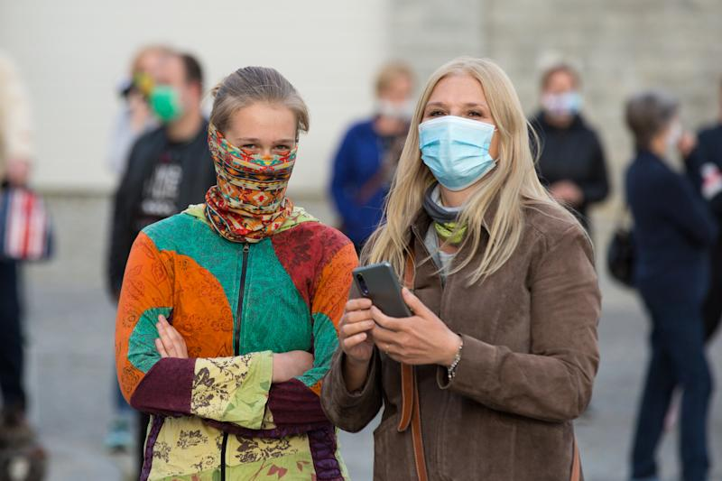 ZGORZELEC, POLAND - 2020/04/24: Women wear face masks as they take part during the demonstration. Hundreds of polish-Germany border residents protest against anti-virus measures as they block them from commuting to work on a daily basis. In response to the COVID-19 pandemic, both countries are requiring those entering to undergo a 14day quarantine period, though Germany makes an exception for cross border commuters, Poland does not. (Photo by Karol Serewis/SOPA Images/LightRocket via Getty Images)