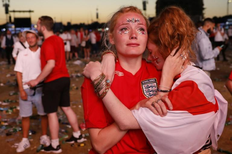 Supporters in London react after England lost their World Cup semi-final to Croatia