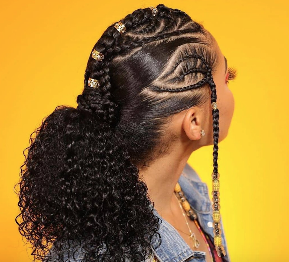 I don't know what my favorite part of this hairstyle is. From the voluminous curls, to the braid pattern, to the jewelry, this look really has it all.