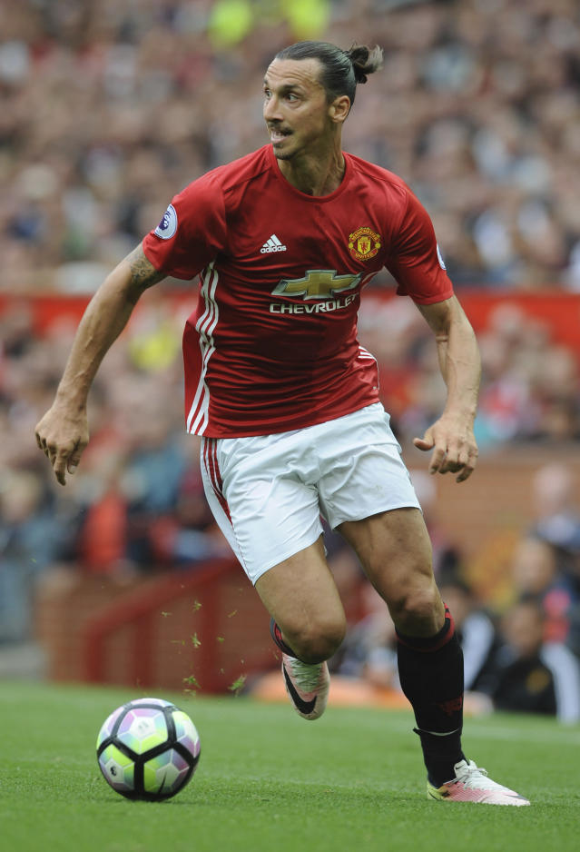 FILe - In this Sept. 24, 2016, file photo, Manchester United's Zlatan Ibrahimovic dribbles the ball during an English Premier League soccer match against Leicester City at Old Trafford in Manchester, England. Sources with knowledge of the deal say Ibrahimovic has signed a two-year contract with Major League Soccer to leave Manchester United and join the LA Galaxy. The sources spoke to The Associated Press on the condition of anonymity Thursday, March 22, 2018, because the deal had not been announced. The agreement was first reported by the Los Angeles Times. (AP Photo/Rui Vieira, File)