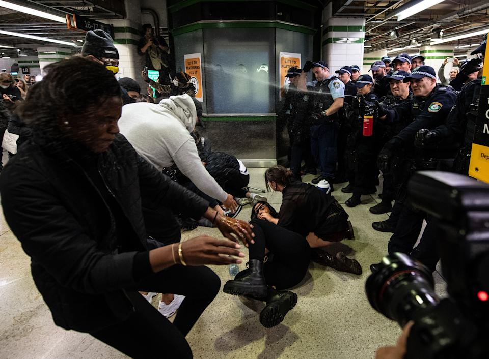 Police spraying protesters with pepper spray inside Central Station. Source: AAP