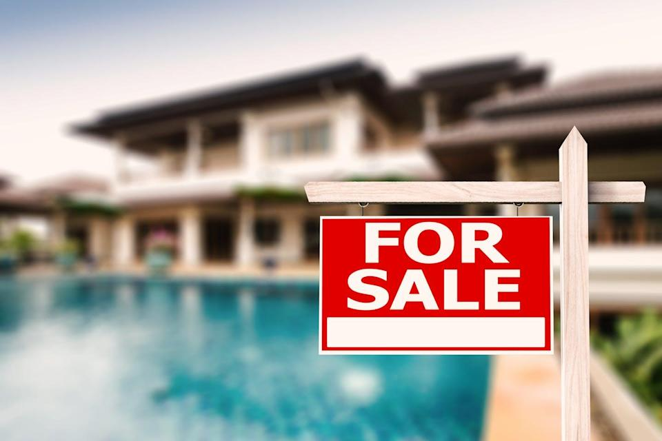 """<span class=""""caption"""">Property values can be diminished by the threat of coastal flooding.</span> <span class=""""attribution""""><a class=""""link rapid-noclick-resp"""" href=""""https://www.shutterstock.com/image-photo/sale-sign-luxury-house-pool-background-297849635"""" rel=""""nofollow noopener"""" target=""""_blank"""" data-ylk=""""slk:Shutterstock.com/Phonlamai Photo"""">Shutterstock.com/Phonlamai Photo</a></span>"""