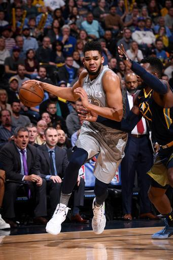 DENVER, CO - APRIL 1: Karl-Anthony Towns #32 of the Minnesota Timberwolves drives to the basket against the Denver Nuggets on April 5, 2018 at the Pepsi Center in Denver, Colorado. (Photo by Garrett Ellwood/NBAE via Getty Images)