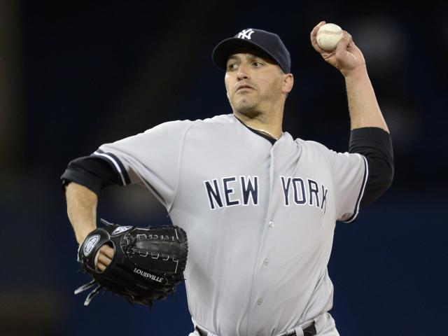 New York Yankees starter Andy Pettitte pitches to the Toronto Blue Jays during first inning MLB American League baseball action in Toronto, Tuesday, Sept.17, 2013. (AP Photo/The Canadian Press, Frank Gunn)