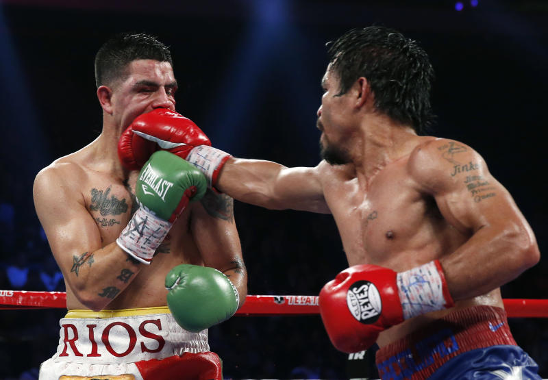 Manny Pacquiao, from the Philippines, right, lands a right to Brandon Rios of the United States during their WBO international welterweight title fight Sunday, Nov. 24, 2013, in Macau. Pacquiao defeated Rios by unanimous decision on Sunday to take the title and return to his accustomed winning ways after successive defeats. (AP Photo/ Vincent Yu)
