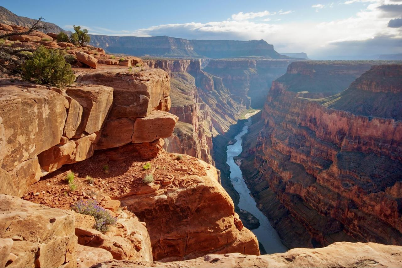 """<p>The Grand Canyon was named a national monument in 1908 and then a national park in 1919. It is a true American icon. From the Griswolds of """"National Lampoon's Vacation"""" to """"The Brady Bunch,"""" this bucket list beauty has long been a part of pop culture. The National Park Service recommends you snap your shots at the """"Golden Hour,"""" aka the time shortly after sunrise or before sunset to capture soft lighting and the canyon's famed warm glow. It's one of <a href=""""https://www.theactivetimes.com/travel/most-spectacular-places-view-sunrise-world?referrer=yahoo&category=beauty_food&include_utm=1&utm_medium=referral&utm_source=yahoo&utm_campaign=feed"""">the best places in the world to watch the sun rise.</a></p>"""