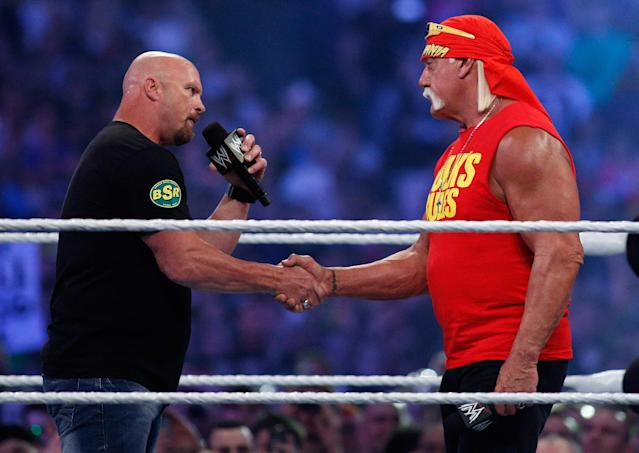 """Stone Cold"" Steve Austin, left, and Hulk Hogan shake hands during Wrestlemania XXX at the Mercedes-Benz Super Dome in New Orleans on Sunday, April 6, 2014. (Jonathan Bachman/AP Images for WWE)"
