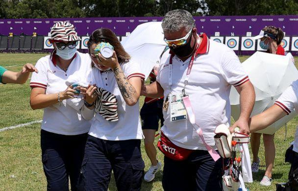 PHOTO: Svetlana Gomboeva of Team ROC is treated for heat exhaustion in the Women's Individual Ranking Round during the Tokyo 2020 Olympic Games at Yumenoshima Park Archery Field on July 23, 2021 in Tokyo. (Justin Setterfield/Getty Images)