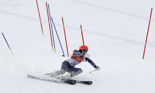 Bronze medal winner United States' Julia Mancuso passes a gate in the slalom portion of the women's supercombined at the Sochi 2014 Winter Olympics, Monday, Feb. 10, 2014, in Krasnaya Polyana, Russia. (AP Photo/Christophe Ena)