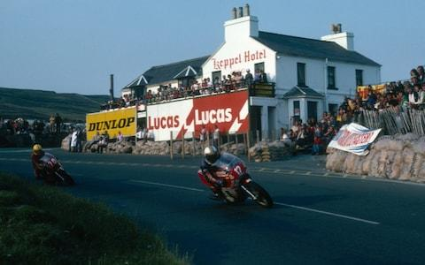 British racing motorcyclist Mike Hailwood (1940 - 1981) leading Joey Dunlop down Mountain Road in the Formula One race at the Isle of Man TT races, June 1978. Hailwood later won the race with Dunlop failing to finish. (Photo by Don Morley/Getty Images) - Credit: Don Morley/Getty Images Europe