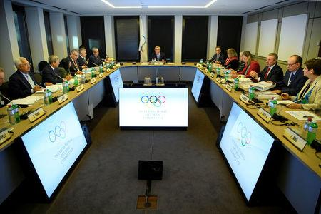 International Olympic Committee (IOC) executive board members listen to president Thomas Bach (C) from Germany, speaking prior to the opening of the first day of the executive board meeting of the International Olympic Committee (IOC) at the IOC headquarters, in Pully near Lausanne, Switzerland December 5, 2017. REUTERS/Pool/Laurent Gillieron