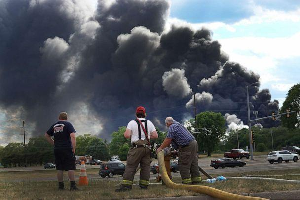 PHOTO: Firefighters from northern Illinois and southern Wisconsin fill their tanker trucks as they continue a day-long battle to extinguish the industrial fire at Chemtool Inc., June 14, 2021, in Rockton, Illinois. (Scott Olson/Getty Images)