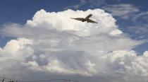 FILE PHOTO: A privet jet comes in for a landing at the Van Nuys airport in the high desert area of Los Angeles County, California