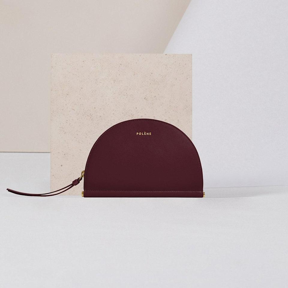 """This Parisian brand is like the French answer to Mansur Gavriel, but with more neutrals. Their Half Moon wallet has an offbeat shape with a classic look—plus, you can stow it in your purse or carry it as a clutch. $130, POLÈNE Paris. <a href=""""https://eng.polene-paris.com/products/demie-lune-bordeaux"""" rel=""""nofollow noopener"""" target=""""_blank"""" data-ylk=""""slk:Get it now!"""" class=""""link rapid-noclick-resp"""">Get it now!</a>"""