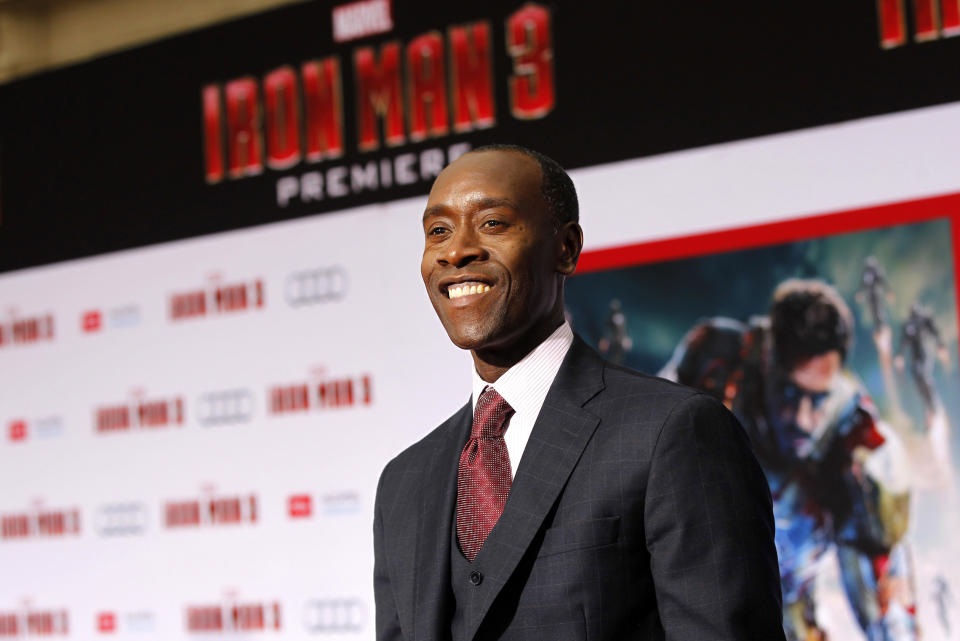 """Cast member Don Cheadle arrives at the premiere of """"Iron Man 3"""" at El Capitan theatre in Hollywood, California April 24, 2013. The movie opens in the U.S. on May 3.  REUTERS/Mario Anzuoni  (UNITED STATES - Tags: ENTERTAINMENT)"""