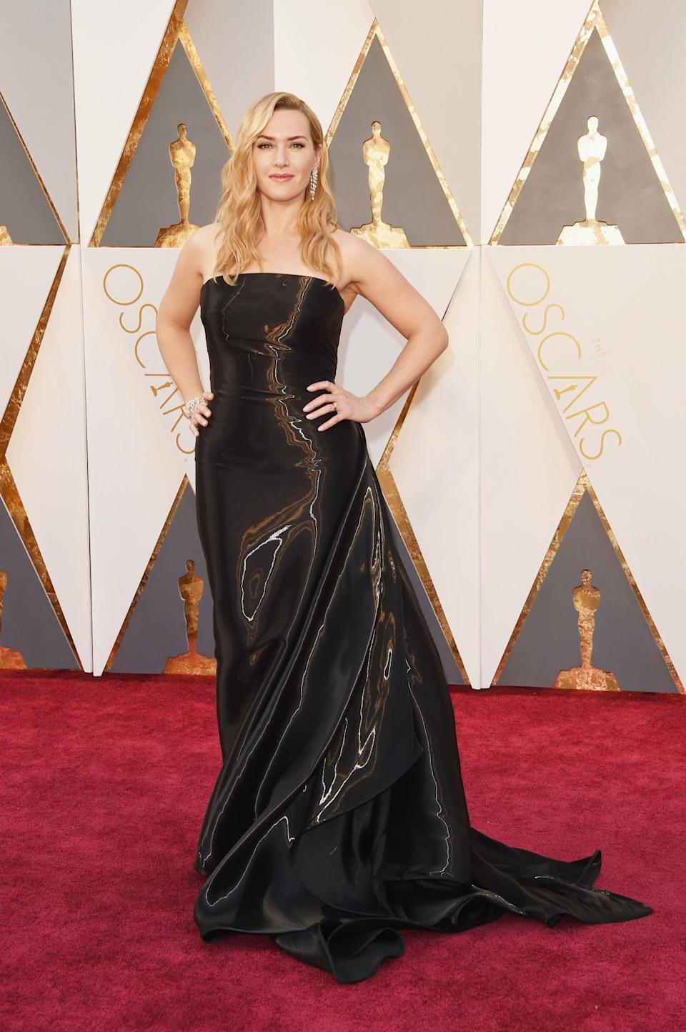 <p>Kate Winslet's Ralph Lauren gown looks like liquid chocolate — and that's a major compliment. <i><i>(Photo: Getty Images)</i></i></p>