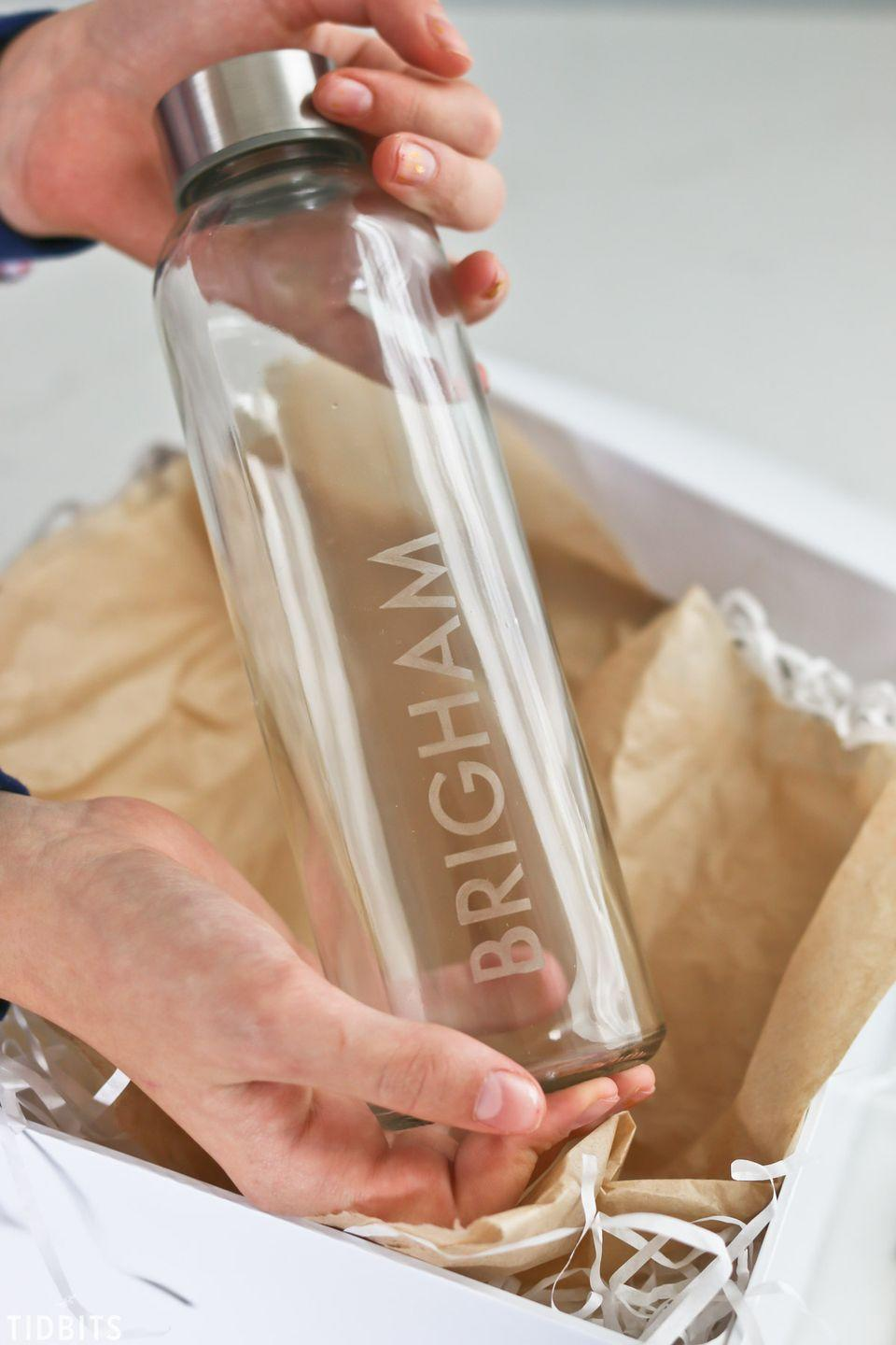 """<p>Put dad or your husband's mark on a sleek glass water bottle. All you need are stencils and some etching cream. </p><p><a href=""""https://www.tidbits-cami.com/etched-glass-water-bottles/"""" rel=""""nofollow noopener"""" target=""""_blank"""" data-ylk=""""slk:Get the tutorial."""" class=""""link rapid-noclick-resp"""">Get the tutorial.</a></p><p><a class=""""link rapid-noclick-resp"""" href=""""https://www.amazon.com/Armour-Etch-Glass-Etching-Cream/dp/B08MHY18H7?tag=syn-yahoo-20&ascsubtag=%5Bartid%7C10072.g.27603456%5Bsrc%7Cyahoo-us"""" rel=""""nofollow noopener"""" target=""""_blank"""" data-ylk=""""slk:SHOP ETCHING CREAM"""">SHOP ETCHING CREAM</a></p>"""