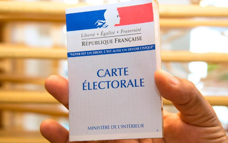 A electoral card from the second round of the French legislative elections at a polling station in Pointe-a-Pitre.  - Credit: AFP