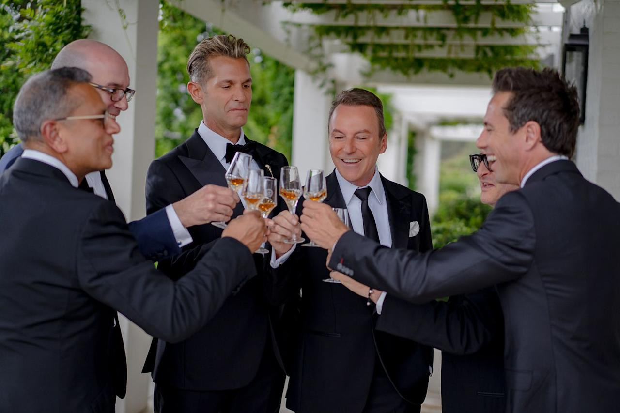 <p>Before going down the aisle, the couple and their groomsmen toasted with Louis XIII cognac.</p>