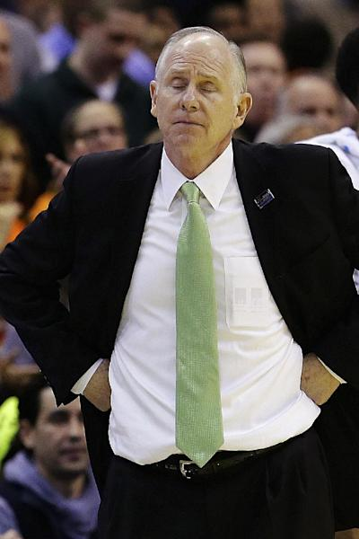 Miami head coach Jim Larranaga reacts in the closing minutes of an East Regional semifinal in the NCAA college basketball tournament against Marquette, Thursday, March 28, 2013, in Washington. (AP Photo/Alex Brandon)