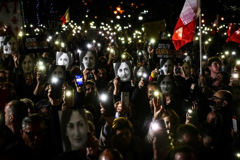 Maltese journalist Daphne Caruana Galizia, seen here protesters' photos, was killed by a carbomb in 2017 (AFP Photo/STRINGER)