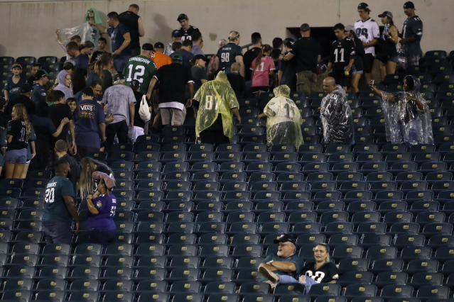 Fans clear the stands as a storm ends a preseason NFL football game between the Philadelphia Eagles and the Baltimore Ravens, Thursday, Aug. 22, 2019, in Philadelphia. (AP Photo/Matt Rourke)