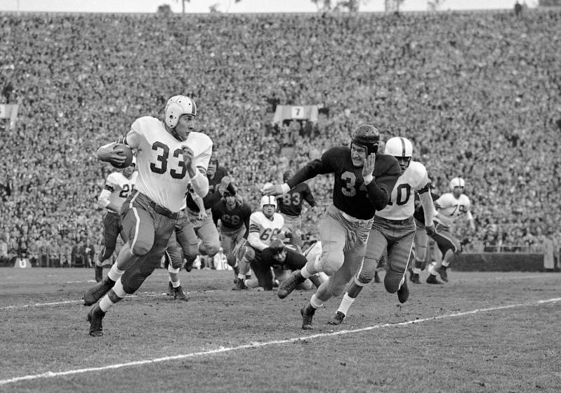 Ohio State fullback Fred Morrison tries to run past California's Paul Baldwin during the 1950 Rose Bowl.