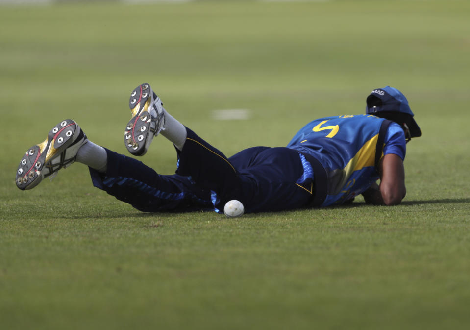 Sri Lanka's Dushmantha Chameera falls on the ground after failing to take the catch of England's Joe Root during the first one day international cricket match between England and Sri Lanka, in Chester-le-Street, England, Tuesday, June 29, 2021. (AP Photo/Scott Heppell)