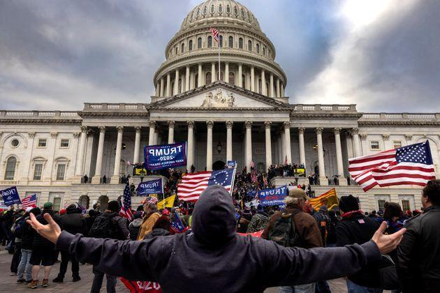 The Jan. 6 riot at the U.S. Capitol was a visible attack on American elections. But the ensuing Republican attempts to institutionalize the lies that fed the insurrection, and turn them into legal attacks on voting rights and elections, pose even more danger to the country's democracy. (Photo: Brent Stirton/Getty Images)